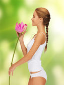 Lovely woman with lotus flower — Stock Photo