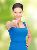 Beautiful woman pointing her finger — Stock Photo