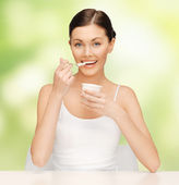 Woman with yogurt — Stock Photo