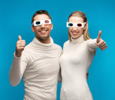 Man and woman with 3d glasses — Stock Photo