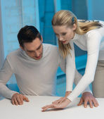Man and woman working with something — Stock Photo