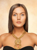 Beautiful woman with necklace — Stock fotografie