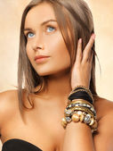 Beautiful woman with bracelets — Photo