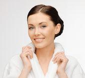 Beautiful woman in bathrobe — Stock Photo