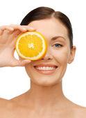 Woman with orange slice — Stock Photo