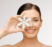 Woman with snowflake — Stock Photo
