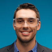 Businessman in protective glasses — Stock Photo