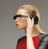 Woman with futuristic glasses — Stock Photo