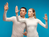 Man and woman working with something imaginary — Stock Photo