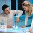 Man and woman working with virtual screens — Stock Photo #19419517