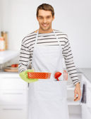 Cooking man at kitchen — Stock Photo
