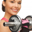 Woman with dumbbells - Stockfoto