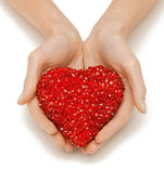 Woman hands holding heart — Стоковое фото