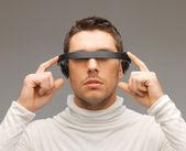 Man with futuristic glasses — Stock Photo