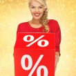 Lovely woman in red dress with percent sign — Stok fotoğraf
