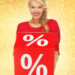 Lovely woman in red dress with percent sign — Photo