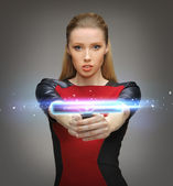 Futuristic woman with gadget — Stock Photo