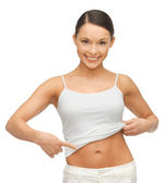 Woman showing her belly — Stock Photo