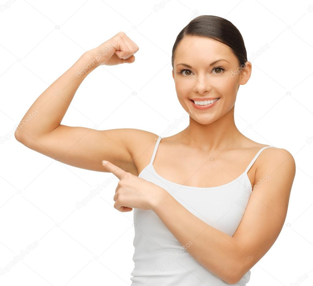 Picture of beautiful sporty woman flexing her biceps — Stock Photo #19731969