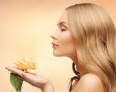 Lovely woman with rose flower — Stock Photo