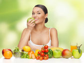 Woman with fruits and vegetables — Stockfoto