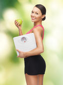 Woman with apple and weight scale — Foto de Stock