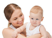Happy mother with adorable baby — Stock Photo