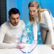 Man and woman working with virtual screen — Stock Photo #20010657