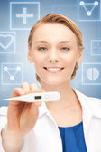 Female doctor with thermometer — Stock Photo