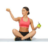 Woman with apple and hamburger — Stock Photo