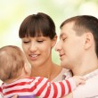 Happy mother and father with adorable baby — Stock Photo #20208335