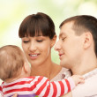 Stock Photo: Happy mother and father with adorable baby