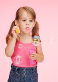 Litle girl with soap bubbles — Stock Photo