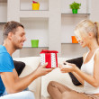 Happy romantic couple with gift — Stock Photo #20481929