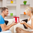 Stock Photo: Happy romantic couple with gift