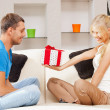 Happy romantic couple with gift — Stock Photo #20482041