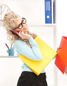 Woman with folders and cell phone — Stock Photo