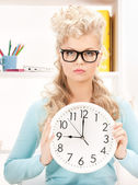 Attractive businesswoman with clock — Stock Photo