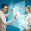 Man and woman working with virtual screens — Stock Photo #21002343