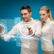 Man and woman working with virtual screens — Stock Photo