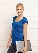 Happy and smiling teenage girl with laptop — Stock Photo