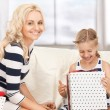 Stock Photo: Mother and little girl with gifts
