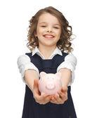 Meisje met piggy bank — Stockfoto
