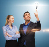 Man and woman with light bulb — Stock Photo
