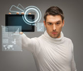 Man with tablet pc and virtual screens — Stock Photo