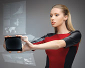 Futuristic woman with tablet pc — Stock Photo