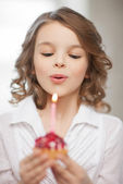 Girl with cupcake — Stock Photo