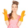 Housewife with protective gloves — Stock Photo #21520473