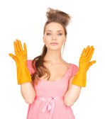 Housewife with protective gloves — Stock fotografie
