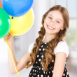 Happy girl with colorful balloons — Stock Photo #21835687